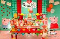 Dessert table and backdrop at a Peppa Pig girl birthday party!  See more party planning ideas at CatchMyParty.com!