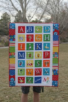 This quilt was made from a Dr. Seuss ABC quilt panel with side borders of coordinating Dr. Seuss fabrics by Robert Kaufman Fabrics. I...