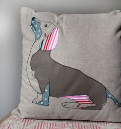 Appliquéd and machine stitched embroidered cushion with Dachshund dog design, using vintage fabric and linen backing, measures 40cm by 40cm aprox.
