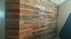 finished pallet wall I am so happy to have it done still deciding if I want to sand it and stain it!