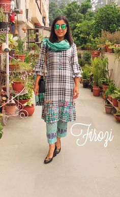 Image may contain: 2 people Embroidery Suits Punjabi, Embroidery Suits Design, Designer Punjabi Suits, Indian Designer Wear, How To Wear Culottes, Salwar Suits Party Wear, Kurta Neck Design, Look Short, Kurta Designs