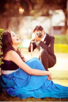 Find the perfect wedding photographer in delhi NCR | Pre wedding shoot tips for Indian couples |. Girl in blue dress being clicked by her fiancé| The ultimate guide for the Indian Bride to plan her dream wedding. Witty Vows shares things no one tells brides, covers real weddings, ideas, inspirations, design trends and the right vendors, candid photographers etc.| #bridsmaids #inspiration #IndianWedding | Curated by #WittyVows - Things no one tells Brides | www.wittyvows.com