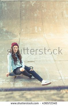 Hipster skateboarder girl with skateboard outdoor at skatepark. Skatebord at city, street. Cool, Funny Tenager. Half-pipe. Skateboarding at Summer. School, schoolgirl