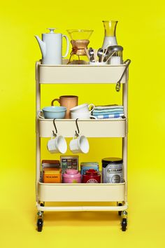 Looking for ideas to hack your ikea raskog cart? This is one of our favorite ideas: a beautiful DIY coffee station in your kitchen! Buying one of these inexpensive kitchen cart kits is a great tip to organize your pantry.