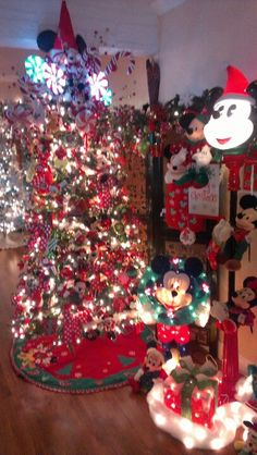 Disney themed tree for my disney kitchen. With all our disney ornaments we get every trip n etc