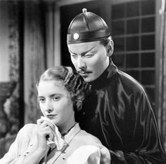 "Nils Asther with Barbara Stanwyck in ""The Bitter Tea of General Yen"" [1933]."