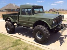 67 Kaiser Jeep M715 (chassis 10140) has been restored with new paint, upholstery and a 350 Olds/automatic in place of its original straight six.