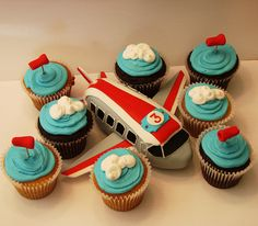 Airplane cupcakes - like the idea of having a main airplane cake and then cupcakes with clouds on top.