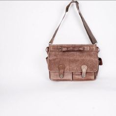 Vintage distressed brown leather messenger bag available at Jenny and Pearl on Etsy.