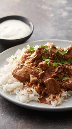 Slow-Cooker Butter Chicken - You don't need a bigger spice cabinet to make this amazing Indian chicken. This tasty dinner recipe calls for just 8 ingredients you might already have on hand.