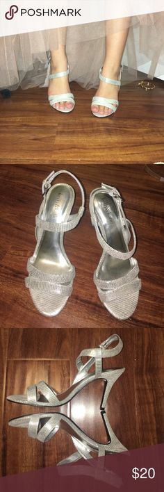 strappy silver evening sandals Ooh la la! Paris ain't burning you, girl! These cute and flirtatious sandals are great for any special event. Only worn once and in excellent used condition 💜 Kelly & Katie Shoes Heels