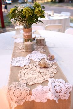 This has the burlap color and the lace... also if you look in the background by the flowers they also used tree stumps as part of the decor... i think they have candles in them.