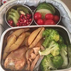 Holiday coloured lunch today, leftover BBQ rotisserie chicken with roasted fingerling potatoes. Snacks of kiwis, pomegranates, cucumbers and cherry tomatoes.