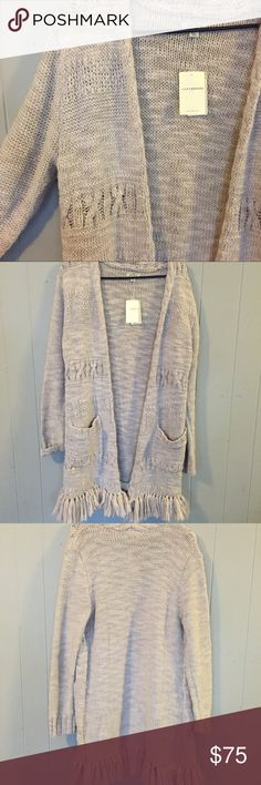 NWT Lucky Brand long knit cardigan w/ fringe New with tags. Lucky Brand long knit cardigan. Fringe on bottom and pockets. Cable knit details. This is a beautiful piece! Measurements (approximate): Underarm to underarm: 21 inches Shoulder to hem before fringe: 31 inches Shoulder to bottom of fringe: 34 1/2 inches Sleeve length shoulder seam to hem: 25 inches - Materials: 70% acrylic, 30% wool - Care: Dry Clean Only Lucky Brand Sweaters Cardigans