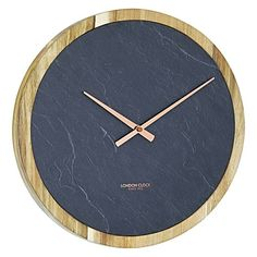 Exude modern luxury in your home with the minimalist looks and practicality of the Carbon Slate & Solid Wood Wall Clock from London Clock Company.