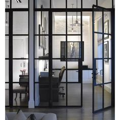 Home office, full wall glass rather than just a door, painted brick too