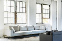 Motti is a sleek and elegant sofa. Long and spacious resting on delicate polished brass feet to achieve a visual balance with the luxurious solid fully upholstered body. Living Room Sofa, Living Spaces, Living Rooms, Mcm House, Sofa Material, Elegant Sofa, Commercial Furniture, Modular Sofa, Soft Furnishings