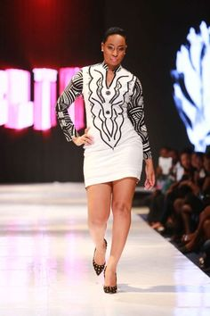 Elikem. Glitz Africa Fashion Week 2013. Accra. Another contestant of BBA-The Chase, Pokello,  that Elikem dated on the show modelling his designs.