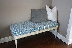 Coffee table transformed into a bench - I would go further and make it a tufted cushion and maybe a bit thicker too. It would be great at the end of a bed in a master bedroom.