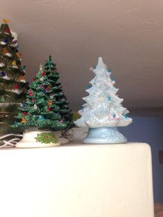 """Why yes, that is a blue ceramic Christmas tree, festooned with draped """"pearls"""" and flowers under some bulbs. I picked this up at a SVDP thrift for $2.50."""