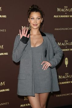 6d829fe1aa8 Bella Hadid Stuns at Magnum X Alexander Wang Event in Cannes!  Photo Bella  Hadid is all smiles as she steps out for the Magnum Photocall on Thursday  ...