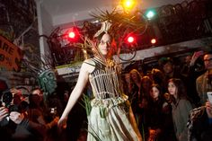 Earth Celebrations--Direct Fashion Show at the Museum of Reclaimed Urban Space. LES, NYC. River grass costume by Michele Brody. Photo by Brian D. Caron.