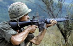 Operation Cook 8 September 1967 Quang Ngai Province Republic of Vietnam: PFC Michael J.) fires is rifle into a suspected Viet Cong occupied area. PFC Mendoza was a rifleman with A Company Battalion Infantry Airborne Brigade Vietnam History, Vietnam War Photos, M16 Rifle, Assault Rifle, Indochine, History Online, Women's History, British History, Ancient History