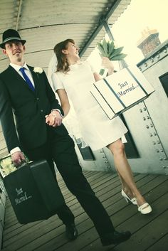 just married suitcases. love her 60s dress too.