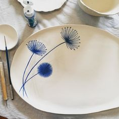 I've been painting in the studio today this is a new stoneware platter nicolahartstudios