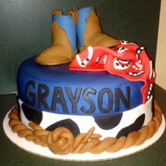 Little cowboy baby shower cake