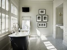 Toth Construction: Amazing ensuite bathroom with cast iron tub with floor-mount tub filler and bath caddy ...