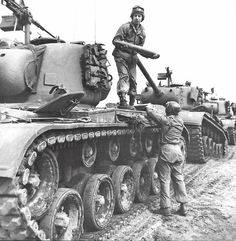 """Loading ammunition into the tank M-26 """"Pershing"""" 66th tank battalion of the American army in tactical exercises; Mainz; Germany; 1952-th year."""