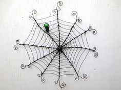 """24"""" Barbed Wire Spiderweb With Green Glass Spider Upcycled Art by The Dusty Raven Gallery, via Flickr"""