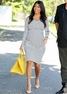 Kourtney Kardashian wearing Gianvito Rossi Pointed Toe Pump in Nude, Lovers+Friends Say It Isn'T So Crop Top and Lovers+Friends Day to Night Pencil Skirt.