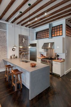 Concrete Countertop Solutions for a Industrial Kitchen with a Exposed Brick and Reiko Feng Shui Interior Design - Loft Renovation by Reiko Feng Shui Design