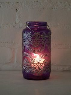 I think this would make a good DIY. A pretty printed mason jar lantern from Free People