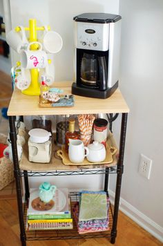 Not a lot of room for a coffee station? Use a decorative microwave cart! Cute idea! (via Love Lola)