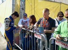 Hendrick Motorsports driver Chase Elliott signs autographs for fans at Phoenix International Raceway.