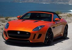 Car I will buy my mom one day. Beautiful. Color is outrageous. Jaguar F-Type