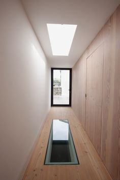aluminium casement doors provide external access on smaller openings whilst glass floors and rooflights allow light to travel vertical between floors www.iqglassuk.com