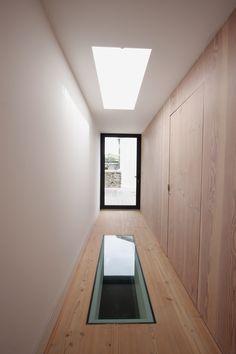 aluminium casement doors provide external access on smaller openings whilst glass floors and rooflights allow light to travel vertical between floors  www.iqglassuk.com