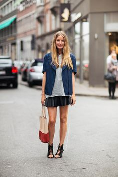 Pair a soft tee with a leather skirt for a daytime look