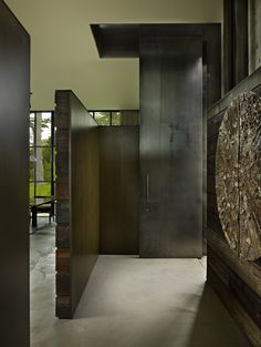 The Pierre by Olson Kundig Architects - detail of wrapped wood terminating into a steel piece that extends past the wrapped wood wall. #lovesteelandwood