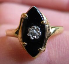Hi there and welcome to In the magpies nest  For sale today is a vintage Victorian mourning style ring. It is size R (US size 8 3/4) and all the metalwork is gold plated. It is set with an eye shaped black glass stone (15x7mms) and in the center is a clear paste stone. It is marked Seta on the inside of the band.  A lovely costume ring for all lovers of vintage jewellery.