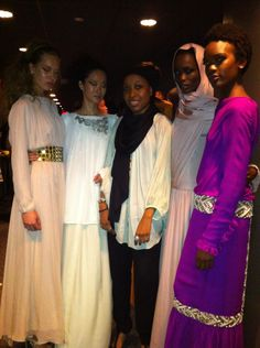 American Muslim designer Nzinga Knight & Spring 2013 #NYFW collection, pictured backstage with runway models just before the show at Lincoln Center. Read more: http://uinterview.com/news/nzinga-knight  -american-muslim-fashion-designer-innova  tes-on-the-catwalk-5388