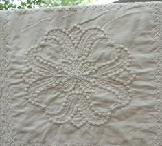 kinda like this - Duvet Cover with White on White Candlewicking - Vintage - Handmade    I love to do Candlewicking! I have made some creations of my own and also from a kit and was pleased with the results. ; )