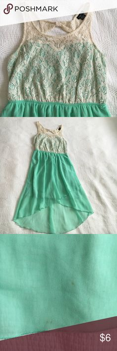 Rue 21 Lace, High Low Dress This dress is super cute and has held up well for Rue 21, which can be flimsy items. A few spots are shown in pictures and price reflects. I have not tried to get these out. The top fits very nicely. Rue 21 Dresses High Low