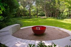 Tucked in the backyard of this Dallas, Tex., home is a private family garden. A circular seating area surrounds the bright red fire pit, making for a cozy outdoor living spot. Landscape Architecture, Landscape Design, Outdoor Seating Areas, Outdoor Spaces, Family Garden, Fire Pit Backyard, Outdoor Living, Outdoor Decor, Amazing Gardens