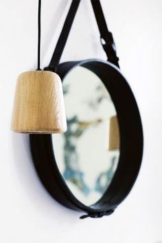 "Mirror image ""I added accessories to warm up the room to avoid it becoming too strict and clinical,"" says Helena. The circular mirror acts as an attractive counterpoint to the sharp geometrics that comes through the tiling and fixtures. Sporting a handsome leather strap, the mirror lends a textural element to the space and is also a point of difference.  10 bathroom beauty basics gallery 3 of 10 - Homelife"