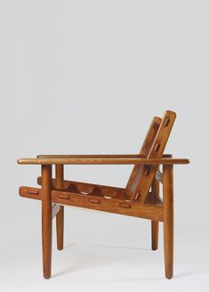 © Erling Jessen. Armchair, Oak and original cognac leather. Denmark, 1960 for Sören Horn. sold by Modernity. Sweden